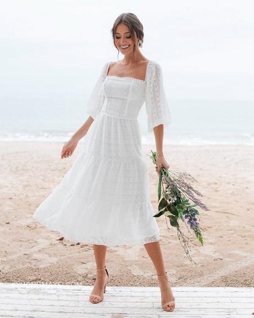 Váy cưới dáng ngắn không thể thiếu trong các đám cưới bãi biển
